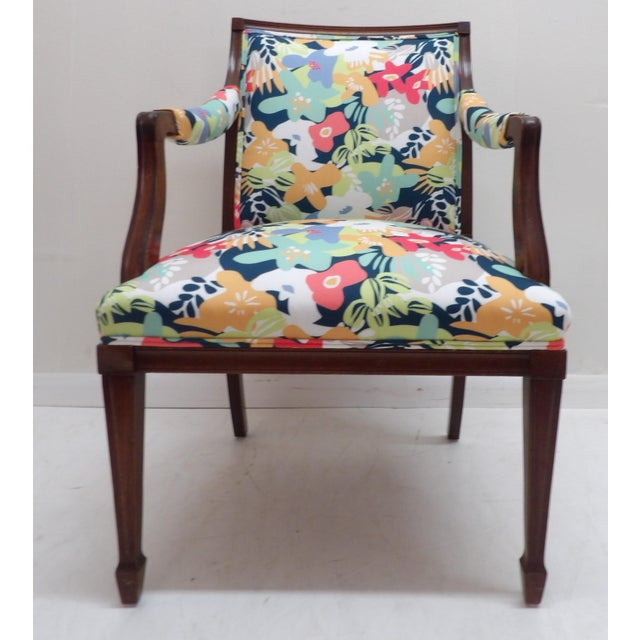 Lively & Colorful Upholstered Side Arm Chair. The vintage chair has a new life with floral Norbar upholstery. The chair is...