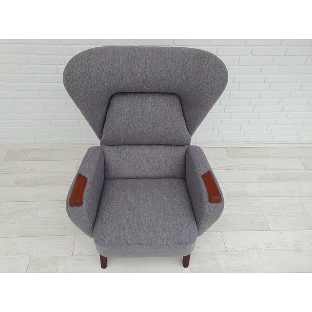 Danish designed armchair. Manufactured by Danish furniture manufacturer in about 1970. Completely renovated, reupholstered...