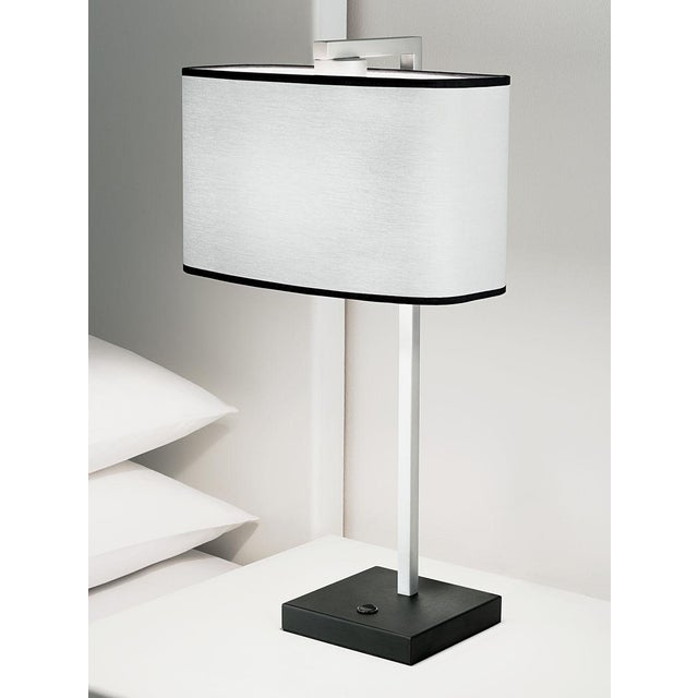 Satin black with aluminium table lamp with an up and over square section column which supports a bowed rectangular shade...