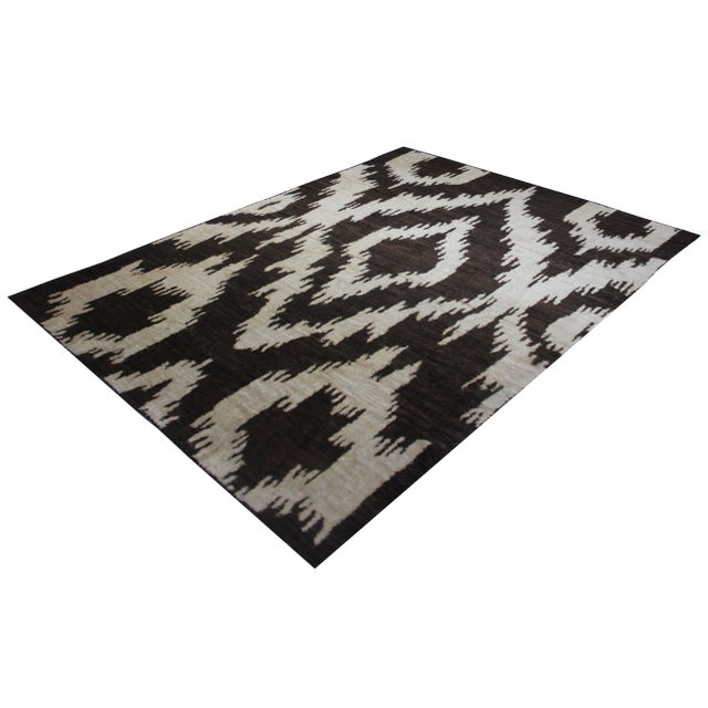 A beautiful handmade modern Ikat rug. Woven by Aara Rugs. Made of 75% wool and 25% cotton, dyed with all natural dyes made...