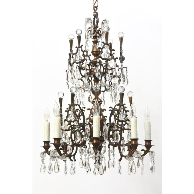 Bronze and crystal chandelier with many round crystal balls. Unusual design. Eight Lights. Completely restored with an...