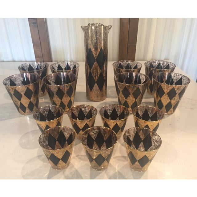 1960s Mid-Century cocktail glasses and pitcher in black & gold diamond pattern - Set of 16 Set includes: - 1 Pitcher...