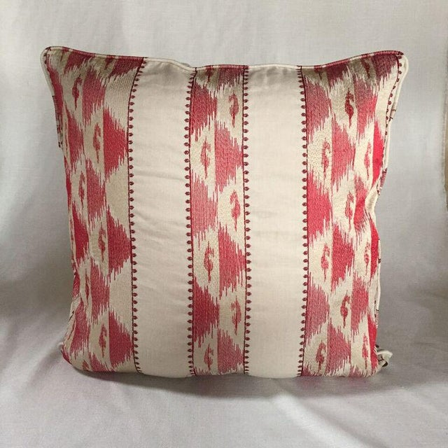 24 x 24 pillow in designer fabrics. Double faced, matching welt, hidden zipper closure and extra full 90/10 feather down...