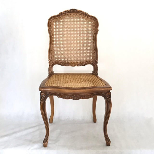 Beautiful set of 6 French caned Louis XV walnut Chairs. Lovely floral carvings throughout! Two have some minor caning...