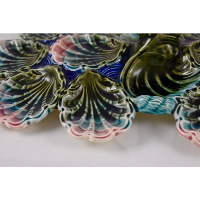 A rare Barbotine majolica master oyster server made by Longchamp of Dijon, France, circa 1860-1880. This server has...