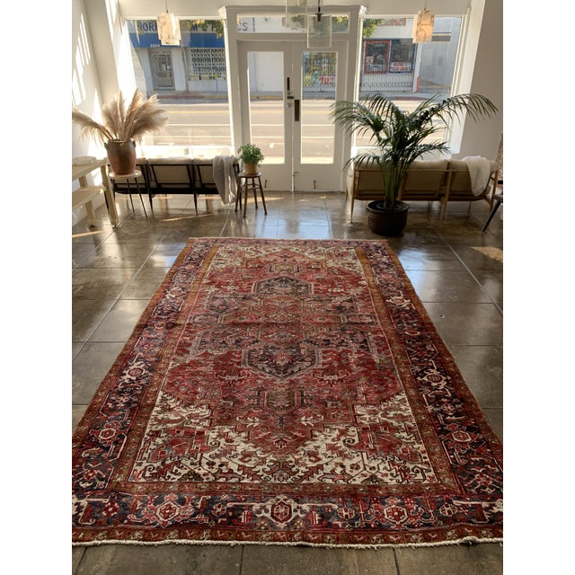 Highly elaborate rusty red palette 1940's Persian area rug. Dense geometry displays craftsmanship and great consideration.