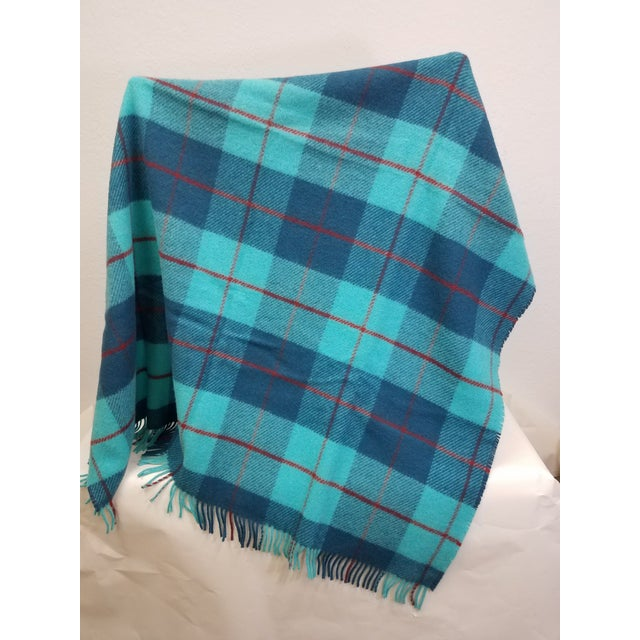 Wool Throw Blue, Aqua and Red in Different Sized Stripes - Made in England A versatile throw in a check design. The colors...