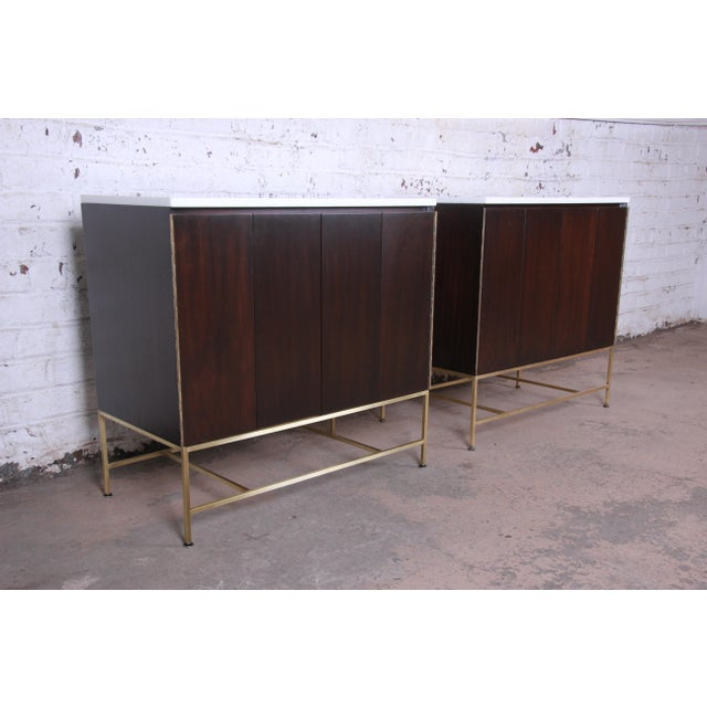 Offering an exceptional pair of mid-century modern sideboard credenzas or cabinets designed by Paul McCobb for his Irwin...