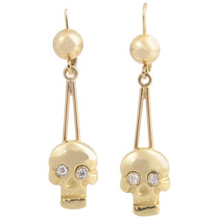 Skull Diamond and Gold Dangle Earrings For Sale