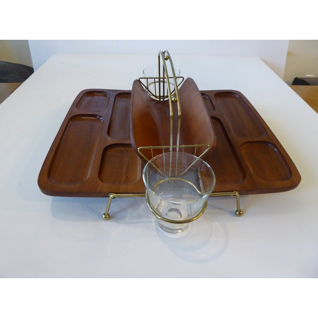 MCM, extremely rare dual wood trays with gold-tone metal accents. Hardwood, probably teak or walnut. Versatile, as each...