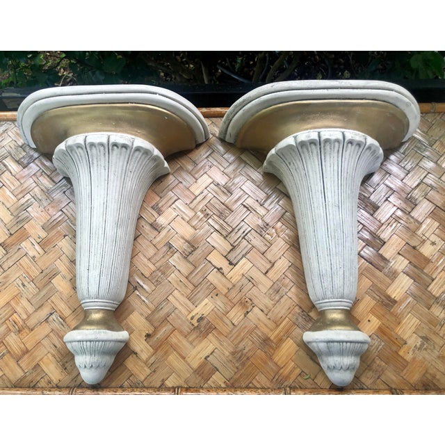 This pair is sure to add bold architectural flair to any room. They are cast plaster and suit many styles from...