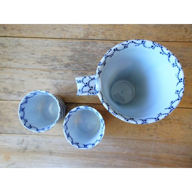 """This as ideal set for serving chilled cold sake. Blue and white color on white porcelain with traditional """"Nami Chidori""""..."""