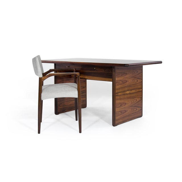 Gorgeous fully restored modern rosewood desk or writing table with twin drawers highlighted by brass pulls, Denmark 1960s.