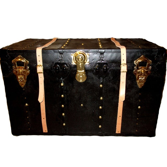 Vintage trunk from the 1930's, covered in metal with large tack head design. Refit with new vegetable tanned leather belts...
