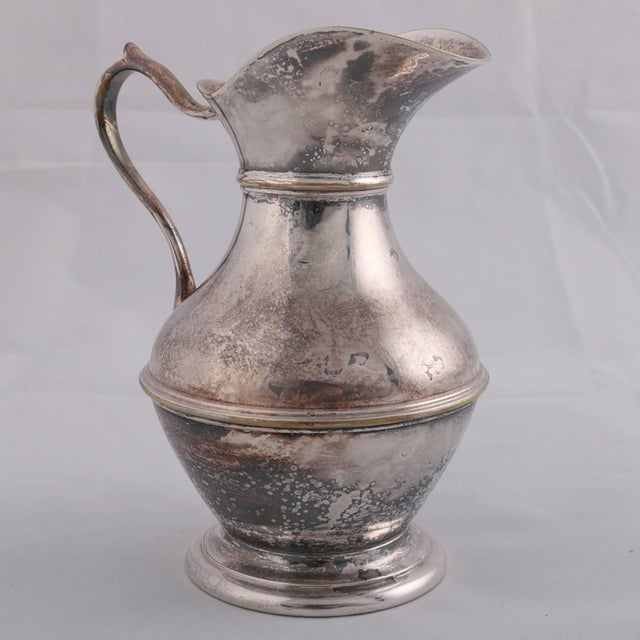 German sterling silver hallmarked Georgian style pitcher features hourglass form with scroll handle, touch marks on base...