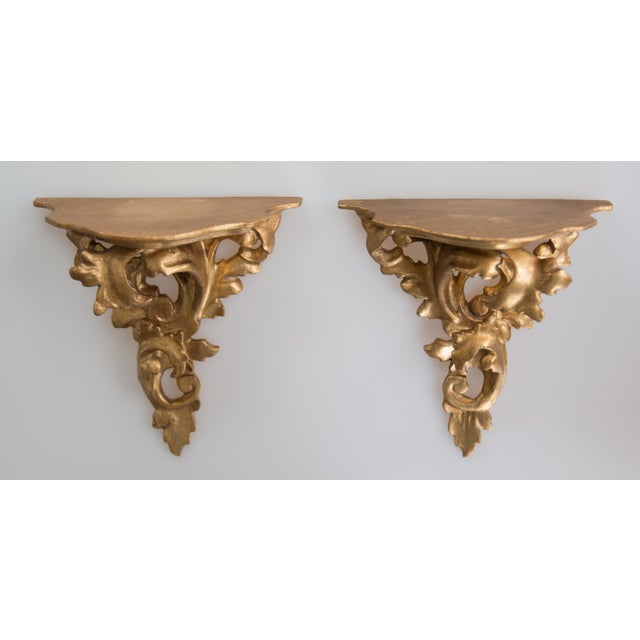 A lovely pair of Italian Florentine Rococo style carved gilt wood wall brackets or shelves. Perfect for displaying...