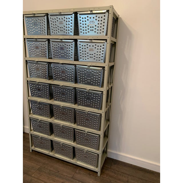 This Vintage Industrial wire basket storage systems by Kaspar Wire Works comes complete with 21 numbered baskets arranged...