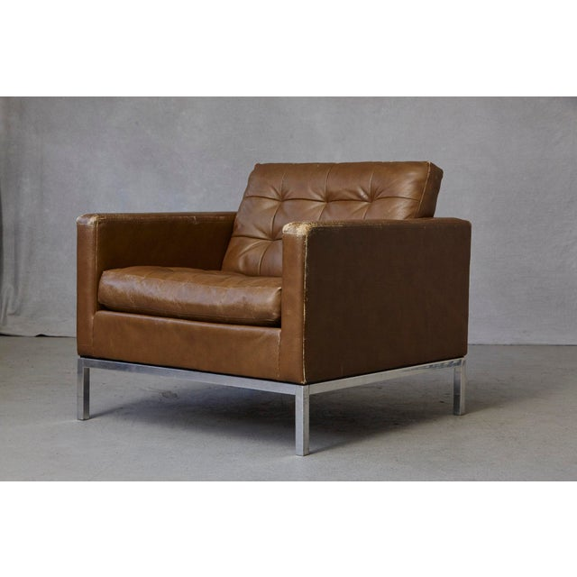 Florence Knoll lounge chair in tan leather with button tufted seat and back on a chrome-plated steel base. Labeled Art...