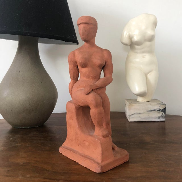 Listed is a wonderful vintage terra cotta (earthenware) clay sculpture of a seated nude woman. Great figurative artistic...