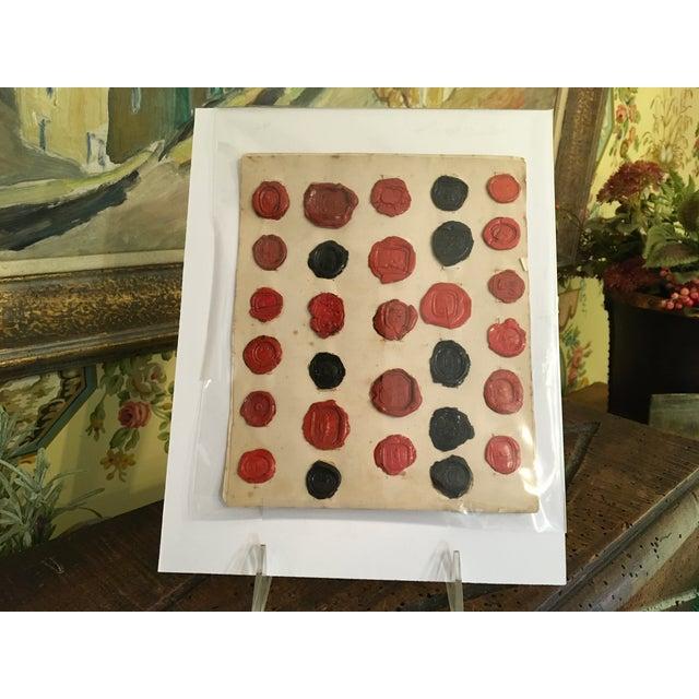 "29 Antique Red & Black English Intaglios Wax Seals. Found in England. Mid 1800s. Original paper dimensions: 7 1/2"" High 6..."