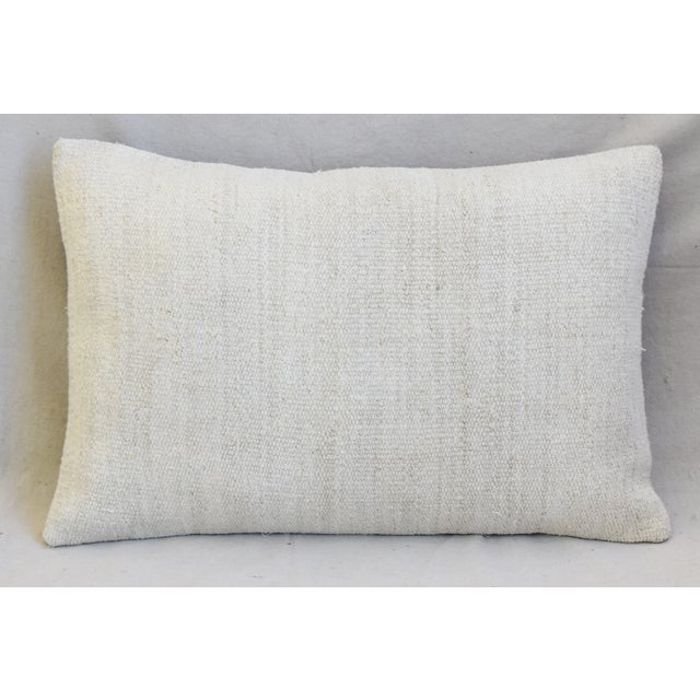 Pair of custom-tailored one-of-a-kind pillows created from vintage/professionally dry-cleaned hand-woven/knotted hemp,...