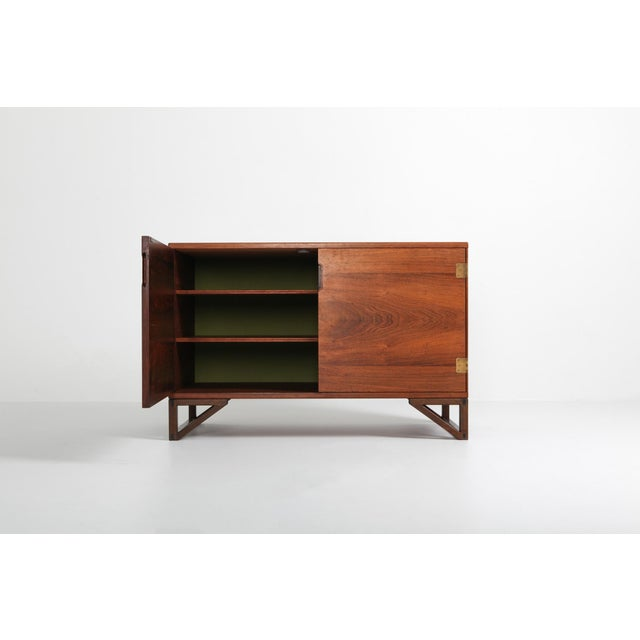 Rosewood and brass cabinet by Svend Langkilde for Lankilde Møbler, Denmark, 1950s. This elegant designed cabinet is...
