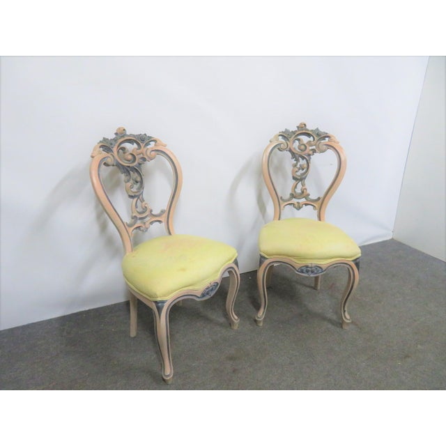 A pair of Victorian Rose Carved side chairs with cream and blue painted frames