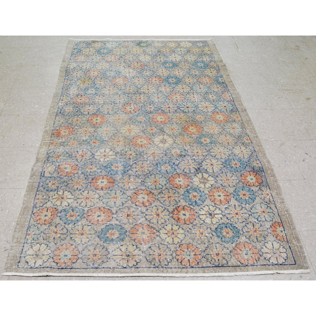 Vintage Turkish Art Deco hand knotted rug with unique pattern and natural colors.