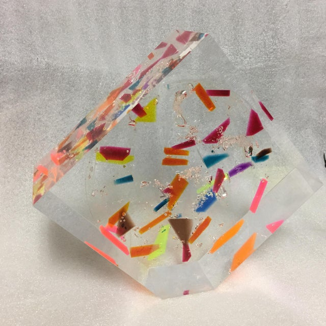 This bright and multi-faceted acrylic block sculpture is whimsically filled with neon-toned confetti colored pieces. From...