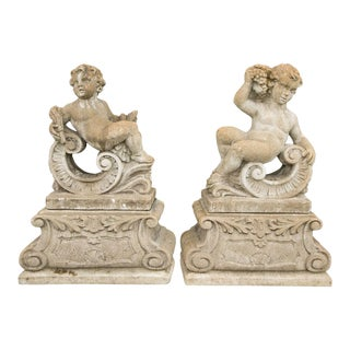 Classical Stone Composite Putti Garden Statues Holding Wheat and Grapes - A Pair For Sale