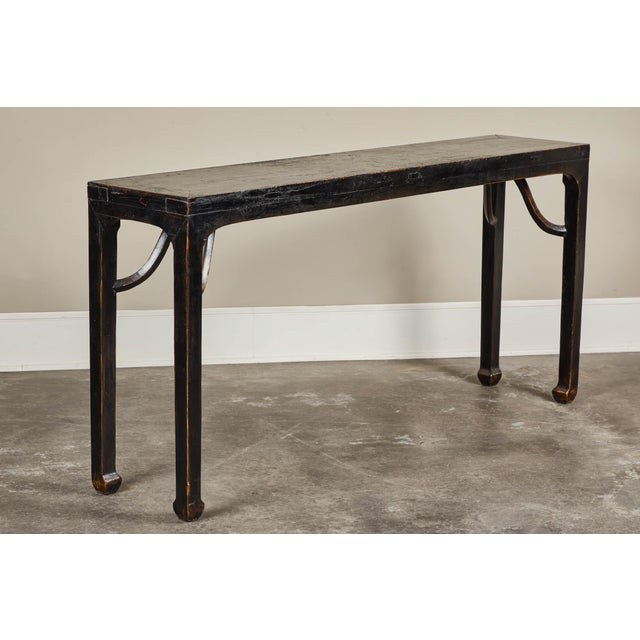 An 18th century Ming-style black crackled lacquer side table with 'giants arms' elbow braces. From Shanshi.