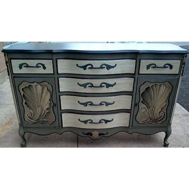 Fabulous pair of tea tables with exquisite hand painted French style decoration with shells and more in a blue/grey and...
