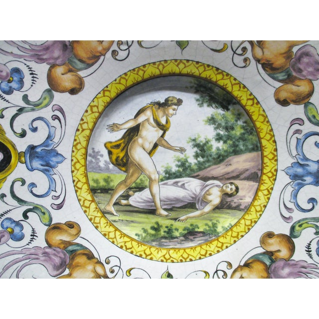 Large Italian Majolica Charger Hand Painted Semi Nudes Impressed AD Late 19th century (see last photo). The center...