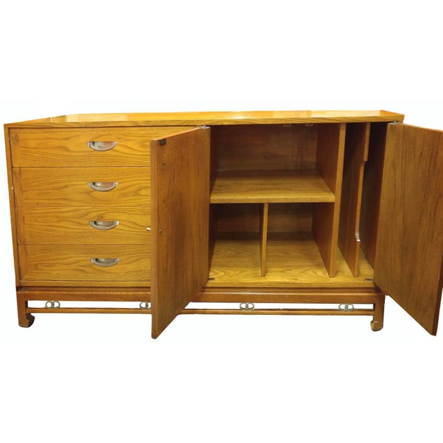 American of Martinsville designer Merton Gershun puts an Asian spin in a classic mid-century buffet with subtle quotations...
