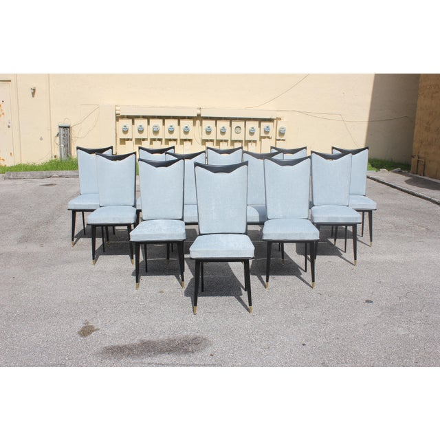 Monumental set of 12 French Art Deco dining chairs, with frames made of solid mahogany that have been ebonized and...