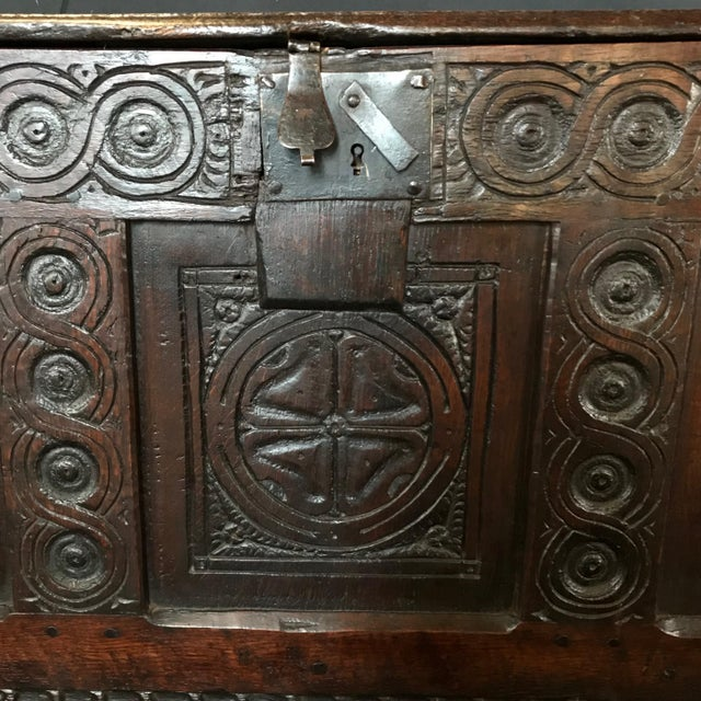 Exceptionally early French coffer chest having a single plank top faced with a moulded edge and with a later iron hasp....