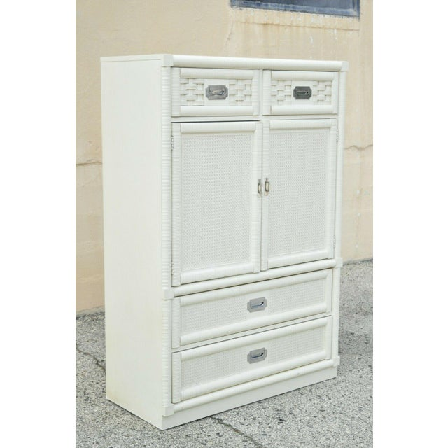Vintage Dixie & Cane Rattan Campaign Style White Tall Chest Armoire Dresser Cabinet. Item features laminate top, chrome...