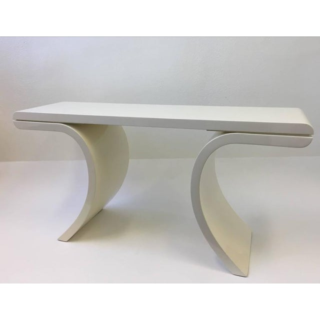 A glamorous high gloss lacquered console table in the manner of Karl Springer. This were usually covered in goatskin or...