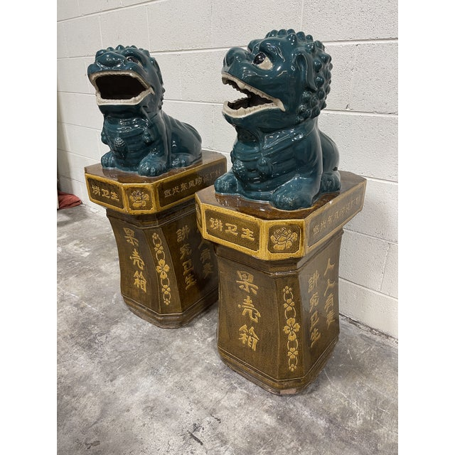 Beautiful pair of large foo dogs on pedestals. These are one piece, so foo is attached to pedestal. Very heavy glazed...