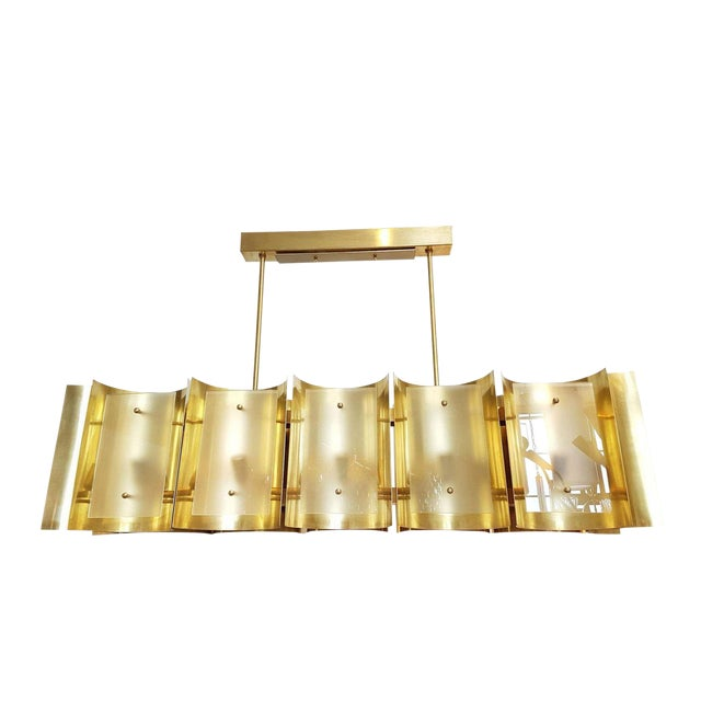Made of 12 polished brass sheets, curved, nesting the light and covered up by a frosted glass. Rectangular shape, with 12...