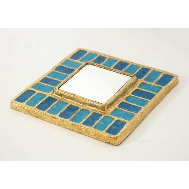 This creation by French designer Francois Lembo is composed of a ceramic frame trimmed in a gold crackled glaze...