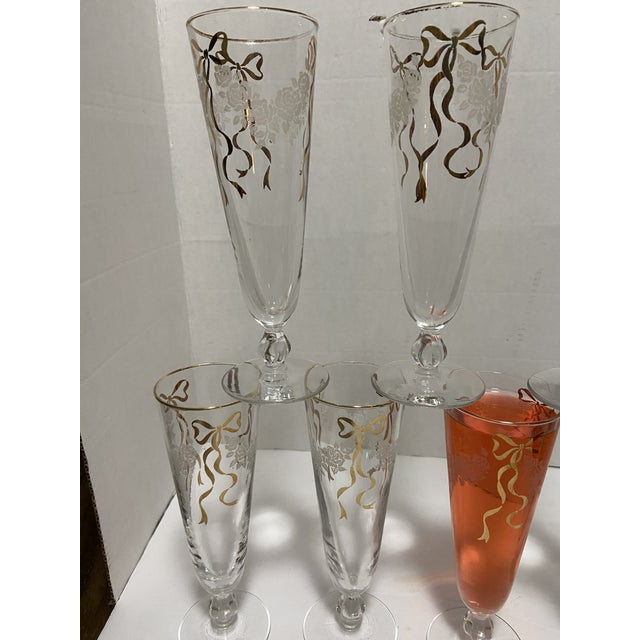 Vintage a champagne Flute Glasses Set 7 Gold Bow with White flowers Great for wedding party or Holidays