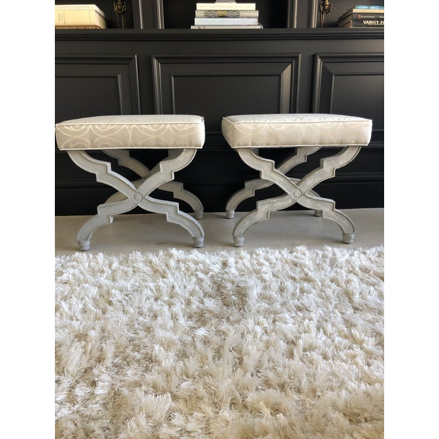 These lovely benches have a rustic, grey painted wood base and are upholstered in a grey & cream Baker fabric with...