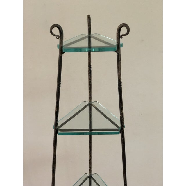 "Early 20th Century French Art Deco forged iron tripod stand with four tiers. A custom fitted 3/8"" glass shelf has been..."