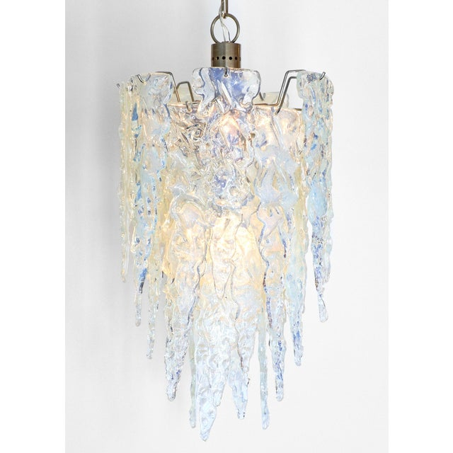 Murano glass chandelier with wonderful texture and shape! This piece has a lot of style and impact. The Murano glass is...