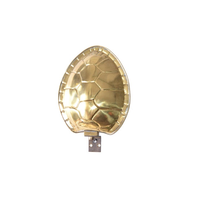 Mid-Century Modern polished Brass Turtle or Tortoise Shell Sconce, Wall Lamp by Chapman. The inside is off white enamel...