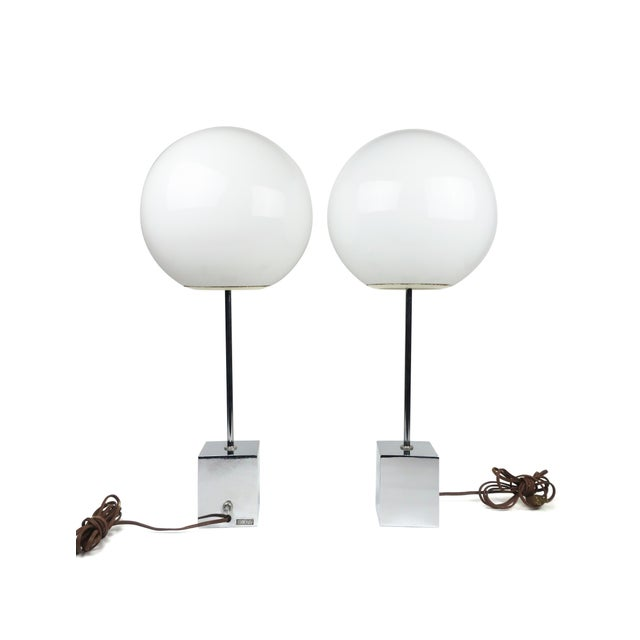 An outstanding pair of vintage Sonneman lollipop table lamps. A glass globe on a chrome stem and base give these a...