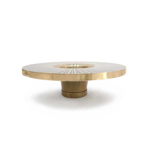 The Vortex Cocktail Tabley by Yann Dessauvages features strips of brass hand inlayed in resin. The Vortex is fully...