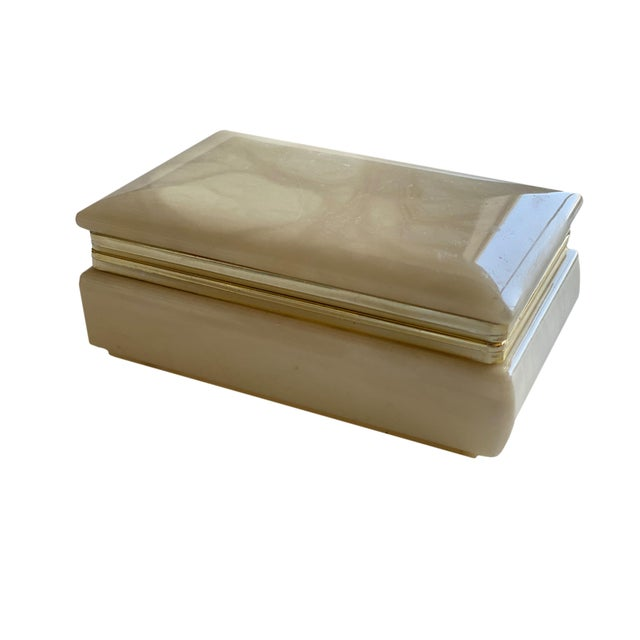 "A mid century Italian hand carved alabaster box with gilt trim. Hinged to open and close. Original sticker on bottom. 4.5""..."