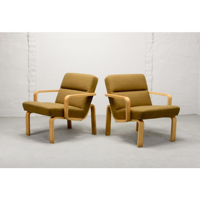 Mid-Century Danish pair of lounge chairs. Designed by Rud Thygesen for Magnus Olesen. Denmark, 1970s Plywood bended...
